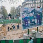 Billboard on a construction site in the center of Paris